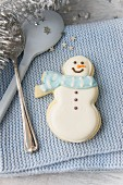 Cutlery with a snowman biscuit