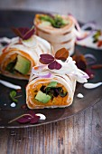 Burritos with avocado, sweet potatoes and red onions