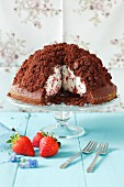 Chocolate cake with whipped cream and strawberries