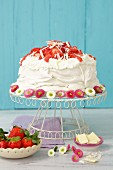 Pavlova with cream and strawberries