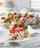Pizza with cream cheese, strawberries, basil and pepper