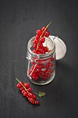 Redcurrants in a flip-top jar