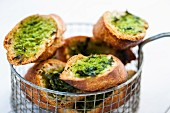 Grilled baguette slices with wild garlic pesto