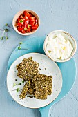 Crackers with dates, chlorella, barley flakes and mixed seeds served with mozzarella and tomatoes
