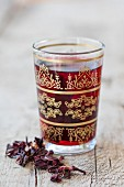 Hibiscus flower tea in an oriental tea glass