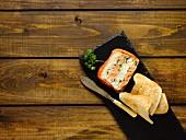 Three fish terrine with toast