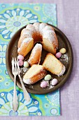 Lemon cake with icing sugar and chocolate eggs