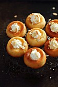 Baba au Rum with cream and slivered almonds