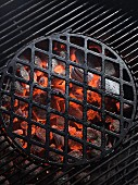 Glowing charcoal and a cooking grid