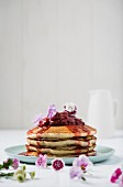 Buttermilk pancakes with strawberry compote and edible flowers