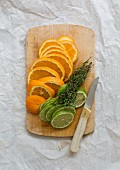 Orange and lime slices on a chopping board
