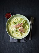 Kohlrabi spiral soup with smoked trout