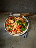 Oriental vegetable spiral salad with tofu and peanuts