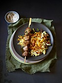 A lamb kebab on a bed of parsnip and potatoes spirals