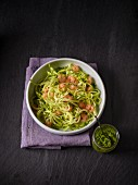 Celery spaghetti with rocket pesto and shrimps