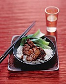 Spicy pork belly on jasmine rice, China