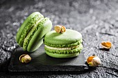Pistachio macaroons on a black stone