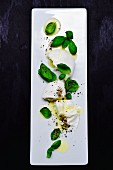 Mozzarella with basil, pepper and olive oil