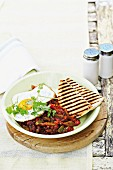 Huevos Rancheros – fried egg with a pepper and bean medley and grilled bread