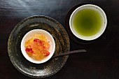 Kaiseki menu: fruit jelly with strawberries and green tea