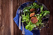 Quinoa fritters on a bed of lettuce