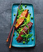 Teriyaki salmon with pea guacamole