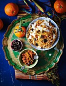 Pasta with orange pesto and black olives