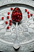 Pomegranate seeds on spoon