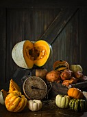 An arrangement of squash with an old pair of kitchen scales