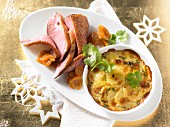 Duck breast fillet with kumquats and potato gratin