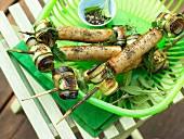 Sausage kebabs with courgette and aubergine rolls