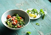 Tabbouleh with pumpkin seeds, cranberries, tomatoes and mint