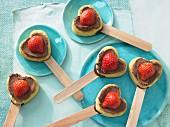 Heart-shaped muffins on sticks
