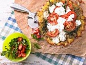 A gratinated potato fritter with tomato and mozzarella