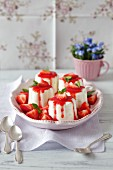 Lime and yogurt puddings with strawberry sauce