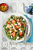 Green bean and strawberry salad with feta cheese, mint and pistachios
