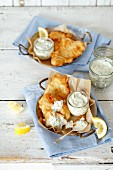 Fried fish with mayonnaise, yogurt, cucumber and dill dip