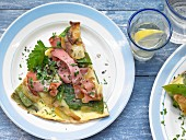 Potato omelette with ham and mange tout