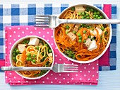 Carrot noodle stew with peas