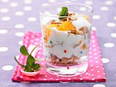 Orange cream with honey and roasted nuts