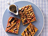 Glazed peach cake with a coffee and chocolate sauce