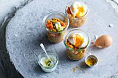 Eggs in glasses with curried lentils