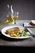 Quick crispy salmon with white wine onions