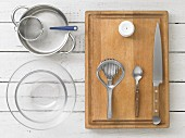 Kitchen utensils: glass bowls, a saucepan, a sieve, an egg piercer and an egg slicer