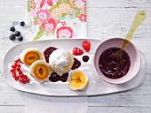 Yeast dumplings with an apricot filling served with berry sauce