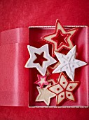 Red and white Christmas star biscuits in a gift box