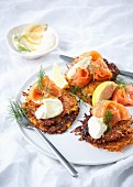 Sweet potato fritters with smoked salmon trout and crème fraîche
