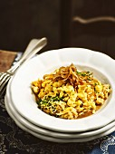 Bayarian 'Krautspaetzle' (soft egg noodles with herbs) with onions in beer sauce