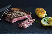 Sirloin steak with baked potatoes