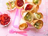 Wafer cones with red berry jelly and green fruit jelly